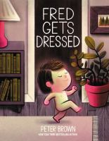 book cover of Fred Gets Dressed by Peter Brown depicting a a boy walking naked in his living room